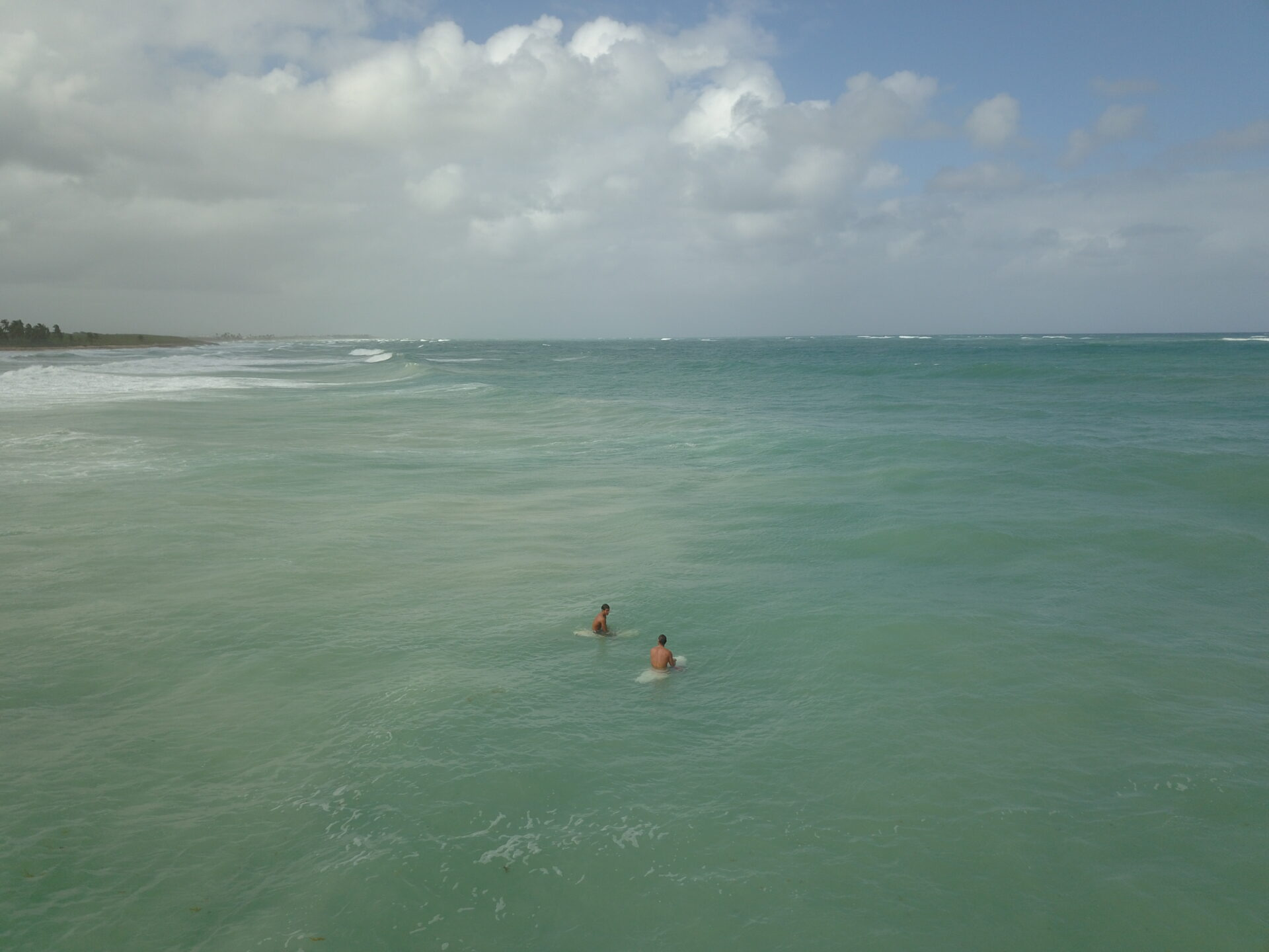 Surfers waiting in the sea