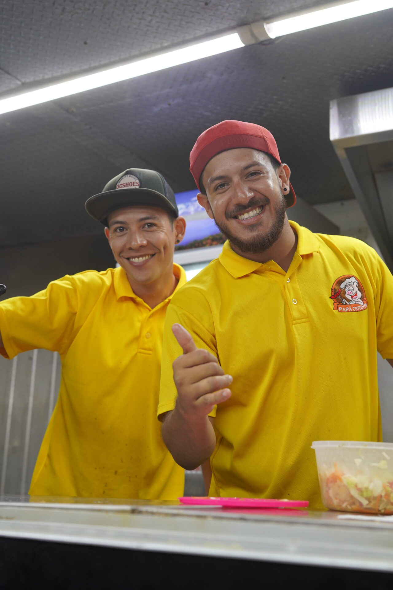 Happy food truck chefs smiling